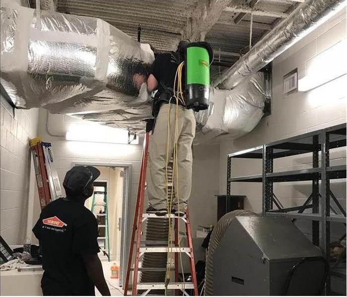 HVAC work being completed by SERVPRO technician